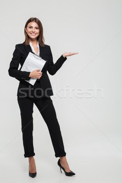портрет радостный молодые деловая женщина костюм Сток-фото © deandrobot