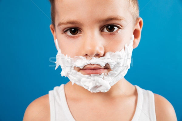 Close up portrait of calm young boy in shaving foam Stock photo © deandrobot