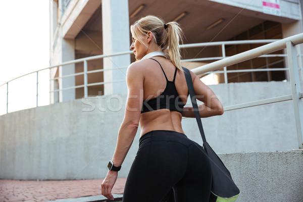 Hátulnézet kép erős fiatal sportok nő Stock fotó © deandrobot