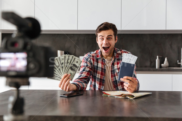 Emotional excited young man filming his video Stock photo © deandrobot