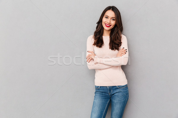 Portrait of young woman with red lips makeup standing with arms  Stock photo © deandrobot