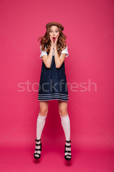 Shocked woman jumping with opened mouth isolated Stock photo © deandrobot