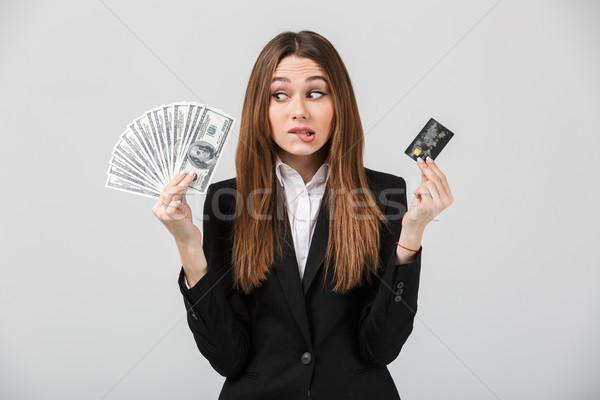 Dalgın hayal kırıklığına uğramış bayan nakit kredi kartı Stok fotoğraf © deandrobot