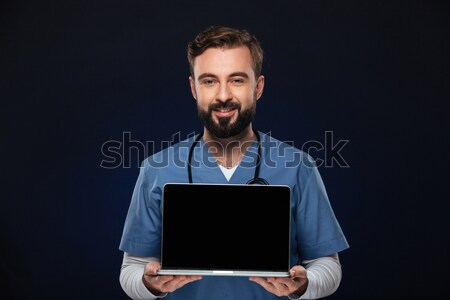 портрет счастливым мужской доктор равномерный стетоскоп Сток-фото © deandrobot