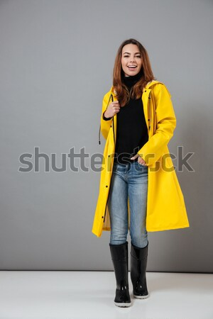 Pleased brunette woman in sweater posing and looking at camera Stock photo © deandrobot