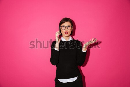 Portrait of a happy young businesswoman Stock photo © deandrobot