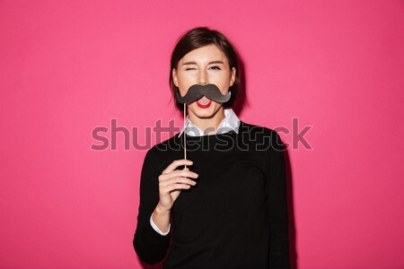 Portrait of a funny cheerful businesswoman Stock photo © deandrobot