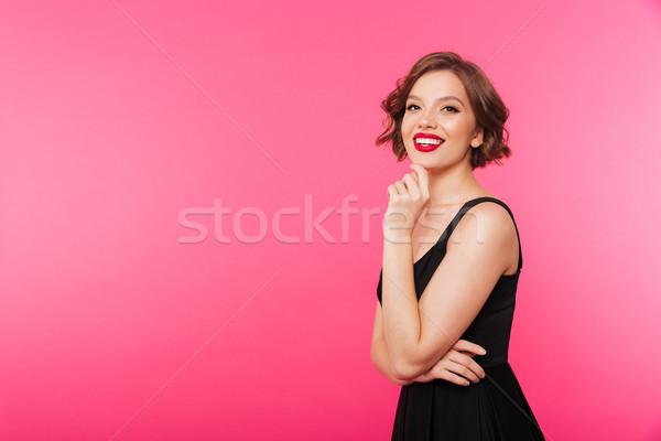 Portret uśmiechnięty dziewczyna czarna sukienka stwarzające stałego Zdjęcia stock © deandrobot
