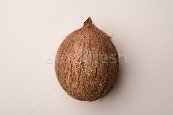 Coconut fruit isolated over white Stock photo © deandrobot