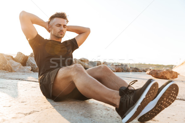 Portrait of a concentrated sportsman Stock photo © deandrobot