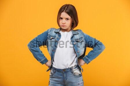 Portret bezorgd weinig schoolmeisje naar camera Stockfoto © deandrobot