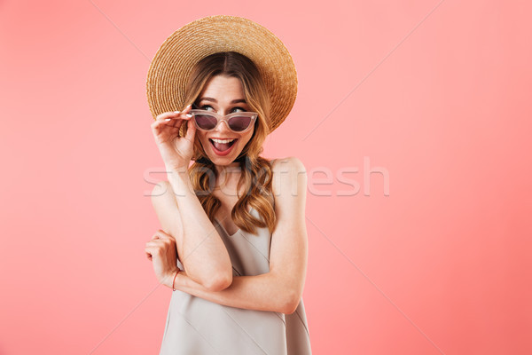 Mystery happy brunette woman wearing in dress, hat and sunglasses Stock photo © deandrobot