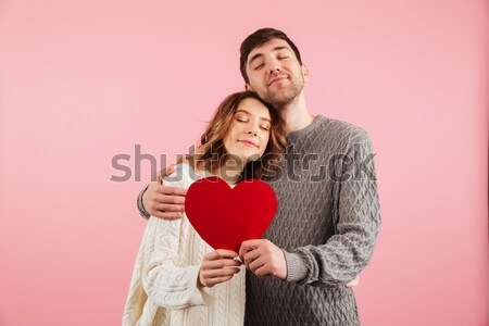 Image of smiling man and woman in love wearing denim clothing hu Stock photo © deandrobot