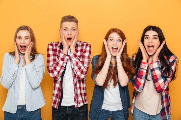 Group of happy school friends screaming Stock photo © deandrobot