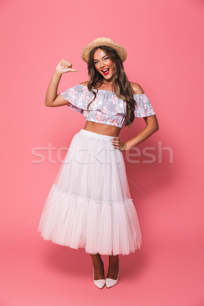 Full length portrait of amazed caucasian woman 20s wearing straw Stock photo © deandrobot