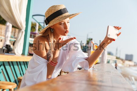 Lovely young girl in summer hat and swimwear Stock photo © deandrobot