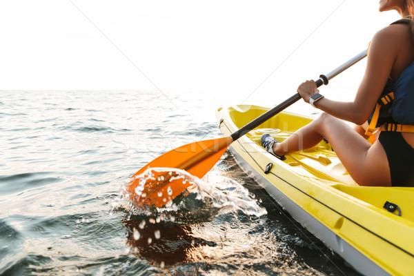 Fiatal nő kajakozás tó tenger csónak fotó Stock fotó © deandrobot