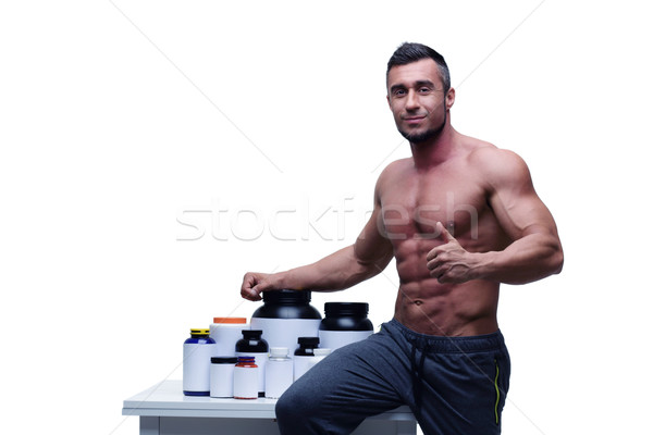 Portrait of a happy man with thumb up and sports nutrition Stock photo © deandrobot