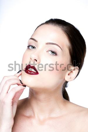 Closeup portrait of a beauty woman making a hush gesture Stock photo © deandrobot