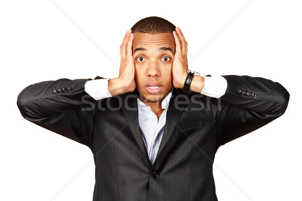 African businessman screaming with fear and a strange face expression (isolated on white) Stock photo © deandrobot