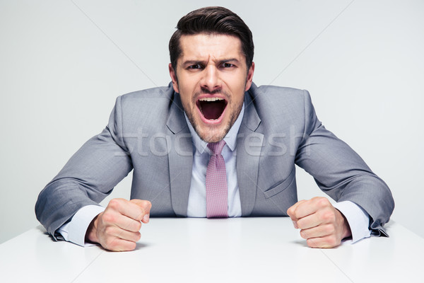 Angry businessman shouting Stock photo © deandrobot