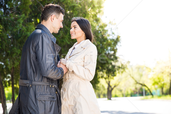 Beautiful couple flirting in park Stock photo © deandrobot