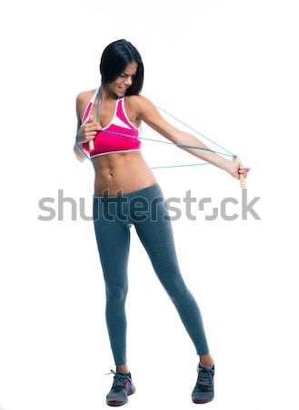 Sports woman stretching with skipping rope  Stock photo © deandrobot