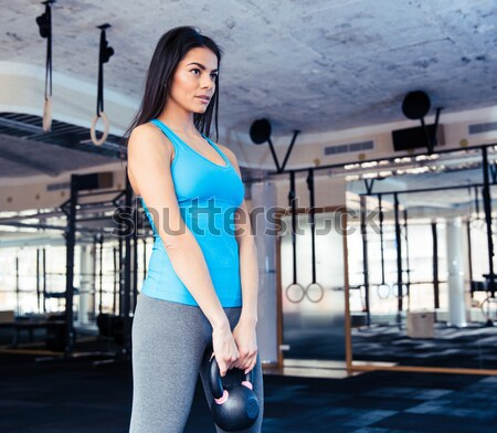 Attractive young woman working out at gym Stock photo © deandrobot