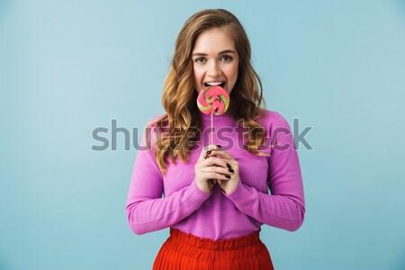 Genç kadın tatlı çörek pembe bakıyor kamera kadın Stok fotoğraf © deandrobot