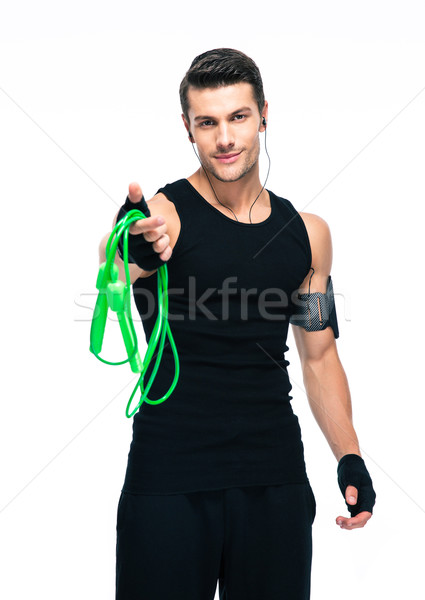 Sports man holding skipping rope Stock photo © deandrobot