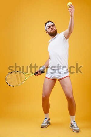 Stock photo: Handsome man im sports wear playing in basketball