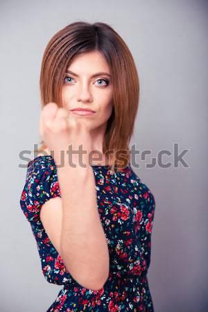 öfkeli genç kadın yumruk gri kız Stok fotoğraf © deandrobot