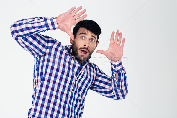 Portrait of a scared man with raised hands up  Stock photo © deandrobot