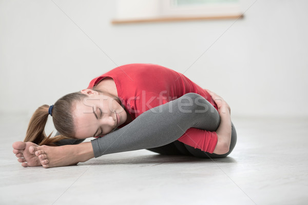 Happy flexible woman doing yoga exercises Stock photo © deandrobot