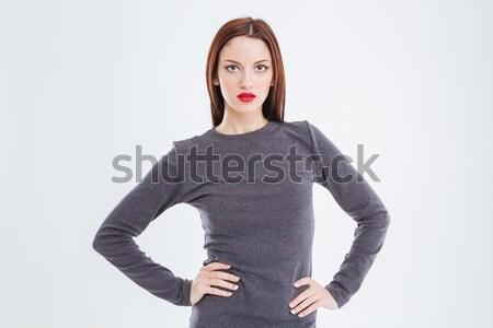 Portré vonzó káprázatos fiatal nő piros ajkak szürke Stock fotó © deandrobot