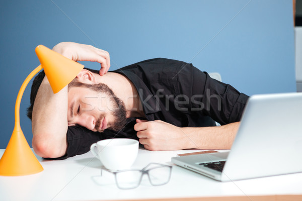 Businessman sleeping on the table Stock photo © deandrobot