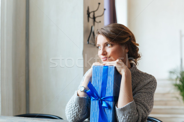 Smiling woman with gift box Stock photo © deandrobot
