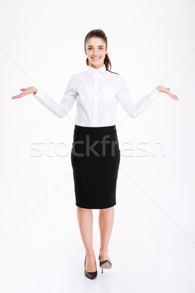 Happy woman in formalwear holding copy space in both hands Stock photo © deandrobot
