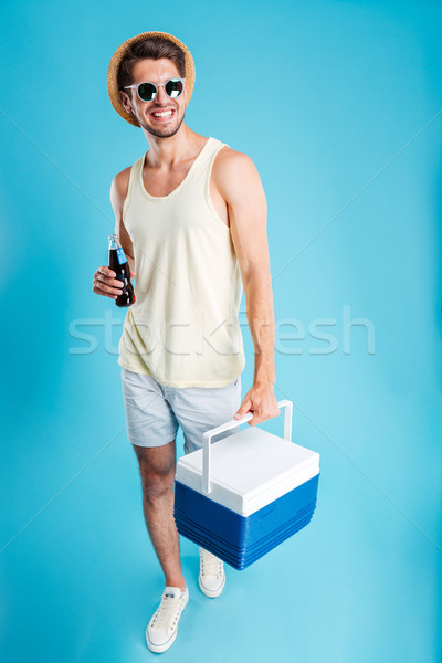 Homem garrafa soda caminhada resfriamento Foto stock © deandrobot
