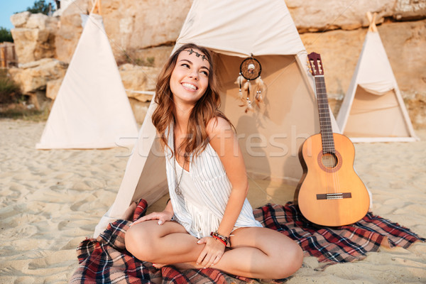 Smiling beautiful hippy girl resting at the beach tent Stock photo © deandrobot