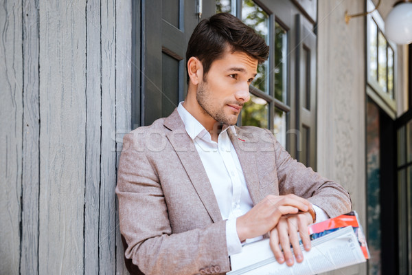 Close-up portrait of man looking at his watch outdoors Stock photo © deandrobot