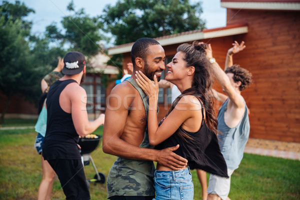 Happy teens dancing and having fun at the picnic area Stock photo © deandrobot