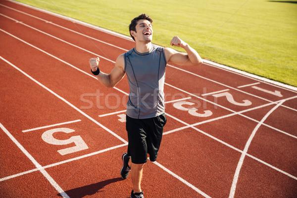 Sportsman celebrating his victory at a stadium Stock photo © deandrobot