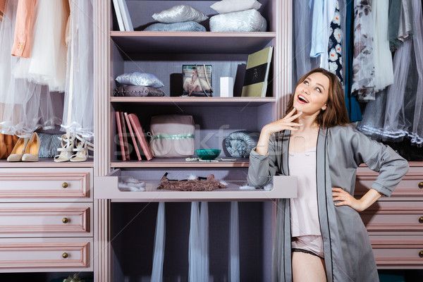 Beautiful young woman in her closet Stock photo © deandrobot