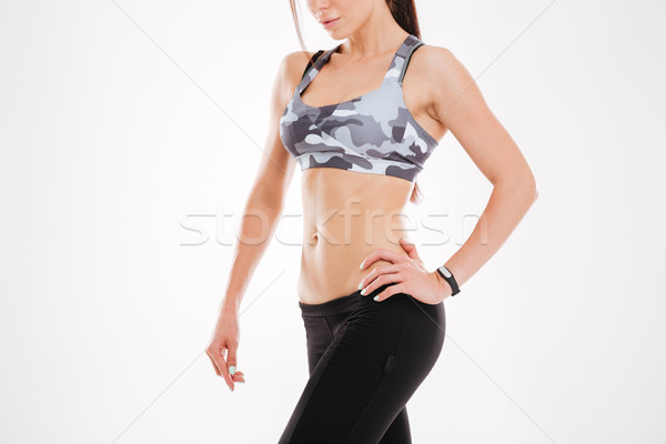 Cropped image of fitness woman Stock photo © deandrobot