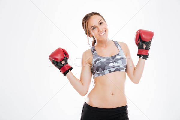 Fiatal nő boxkesztyűk stúdió néz kamera felső Stock fotó © deandrobot