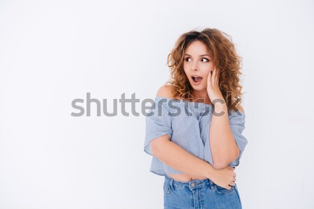 Surprised woman in singlet Stock photo © deandrobot