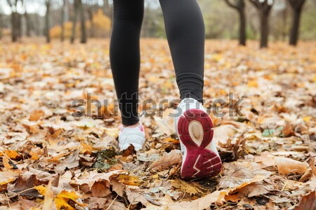 Cropped photo of girl runner in warm clothes running Stock photo © deandrobot