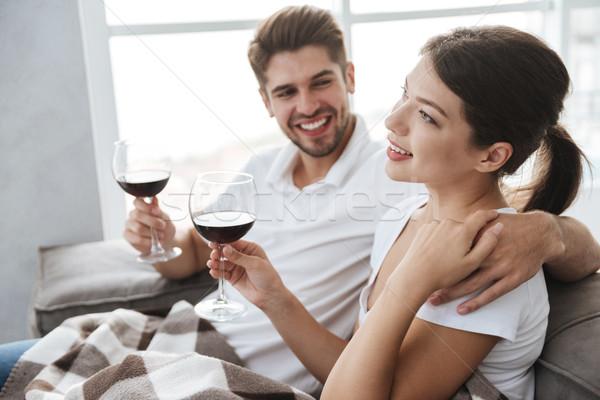 Pár iszik vörösbor otthon együtt gyönyörű Stock fotó © deandrobot