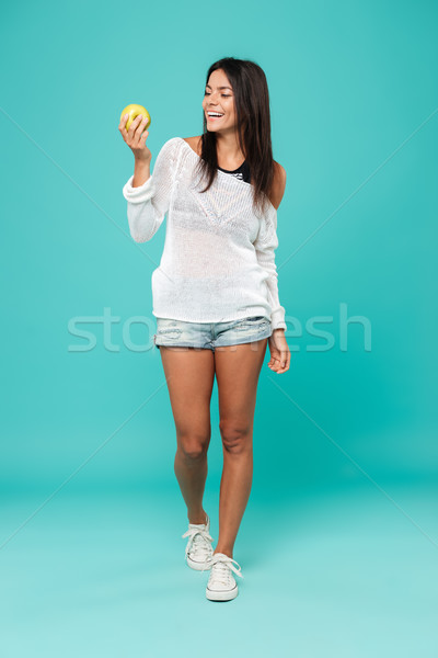 Vertical image of Woman in beachwear with apple Stock photo © deandrobot